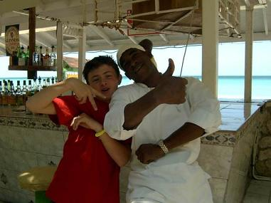 Curtis and one of the cooks at a beach restaurant