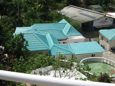 Rooftop of guest house, looking down from swimming pool.