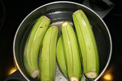 Green banana in a pot