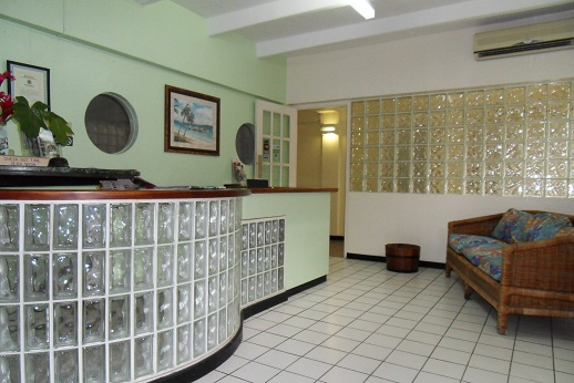 front desk at pineapple court hotel